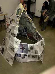 build a structure from newspaper and masking tape in teams; no talking allowed 10 min.