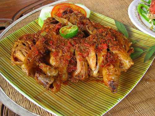 Betutu is a side dish made ​​from chicken or duck a whole that contains spices, then roasted in the husk fire. Betutu has been known throughout the district in Bali.  Bali - Indonesia