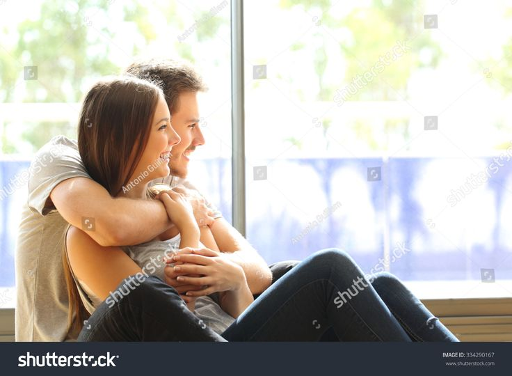 Couple or marriage in his new home looking through the window