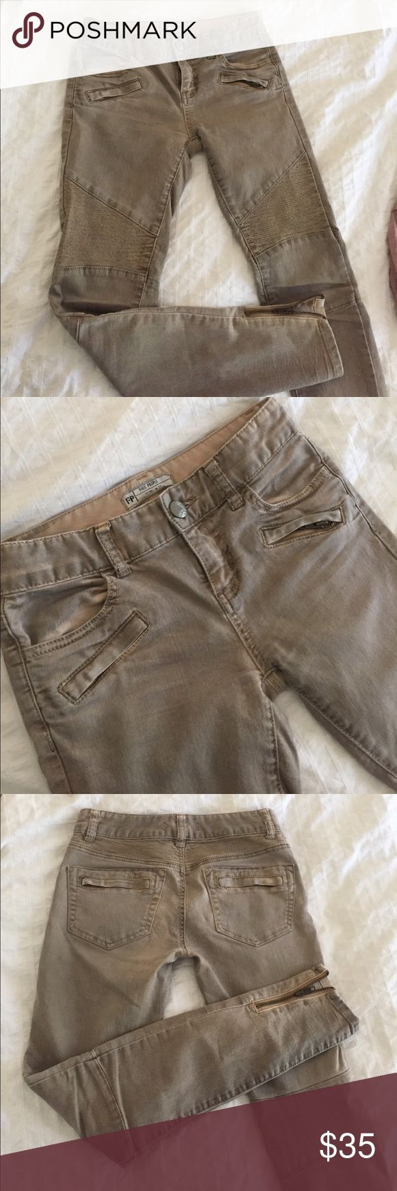 Free People moto khaki jeans-- size 24 Free People khaki jeans. Moto style. Ankle length. Low rise. Ankle zippers. Cute details. Size 24. 76% cotton, 20% polyester, 2% spandex. Free People Jeans Ankle & Cropped