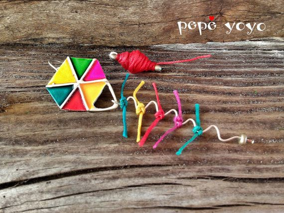 Kite and kite spool handmade sterling silver by pepeyoyojewellery