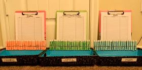 Put clothespins on the outside of a tray and students turn it around when they turn in their work!!