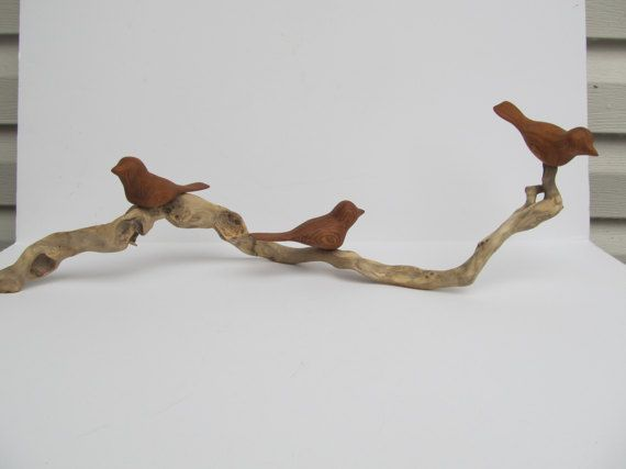 Hand carved birds on a driftwood stick by CarvaWhile on Etsy