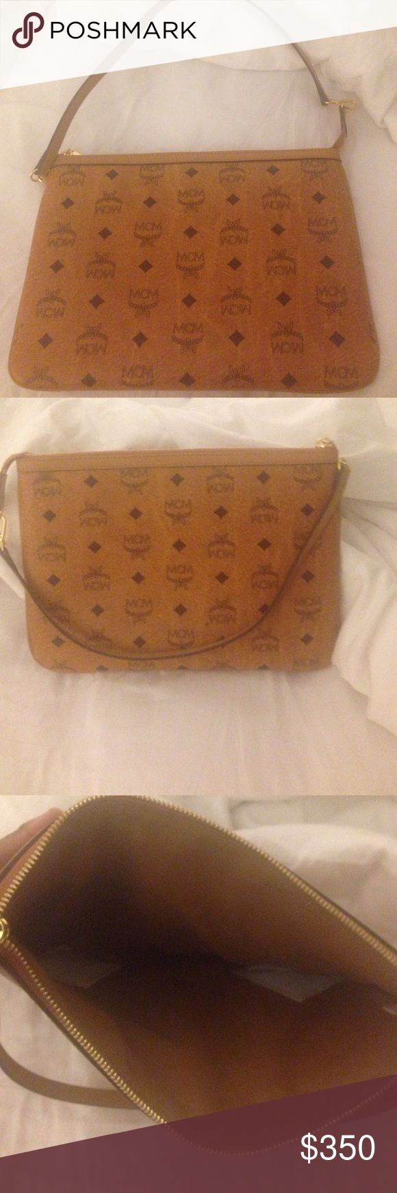 MCM Clutch Brand new MCM clutch comes from a smoke free home MCM Bags Clutches & Wristlets