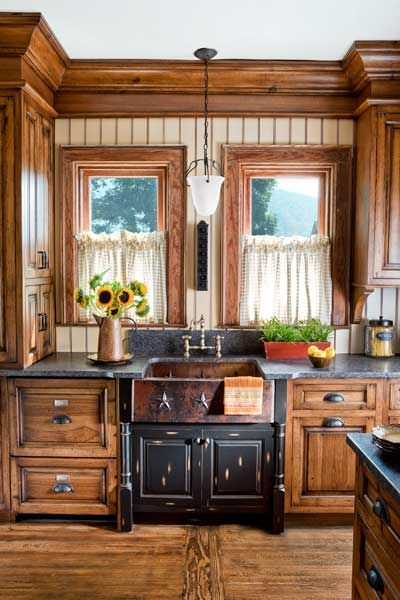 kitchen remodel after with copper sink, beadboard backsplash, pendant light and hickory cabinets