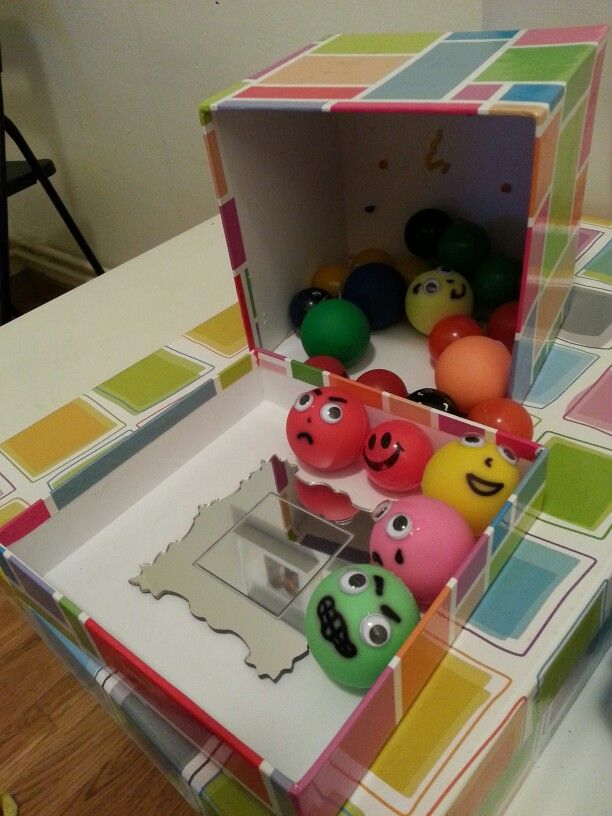 Emotions in a box! Dollar store bouncy balls, googly eyes and a sharpie. Glue a mirror to the lid of the box. Kids identify, express, mimic & explain when they feel like the face they took out.