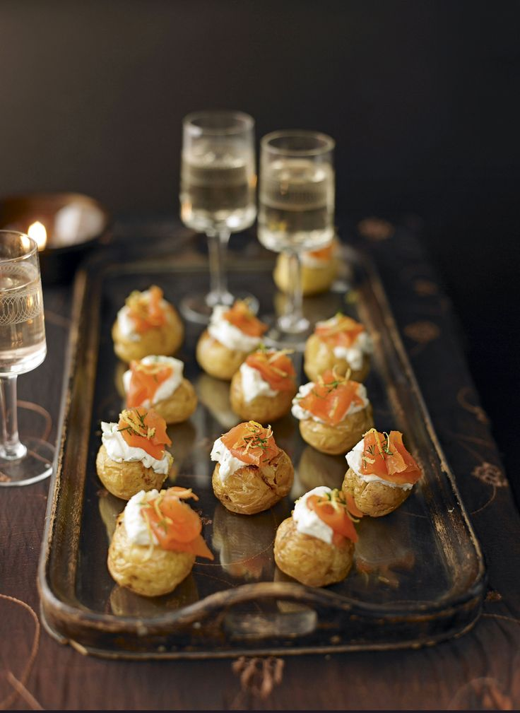 Mini jacket potatoes: smoked salmon adds a sophisticated note, but you can make these cute little canapés with any combination of fillings you like. http://www.hglivingbeautifully.com/2015/12/08/entertaining-a-crowd-at-christmas/