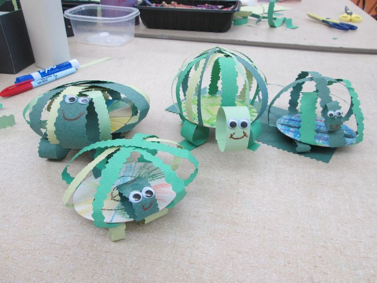 3-D turtles!!  Use textured scissors to cut strips or let the kids cut strips and add googly eyes.