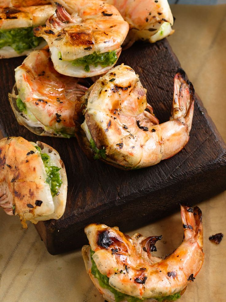 Jumbo Shrimp Stuffed with Cilantro and Chiles : Juicy shrimp are stuffed with a flavorful mixture of garlic, jalapenos, scallions and cilantro that also adds vibrant color to this two-bite appetizer.