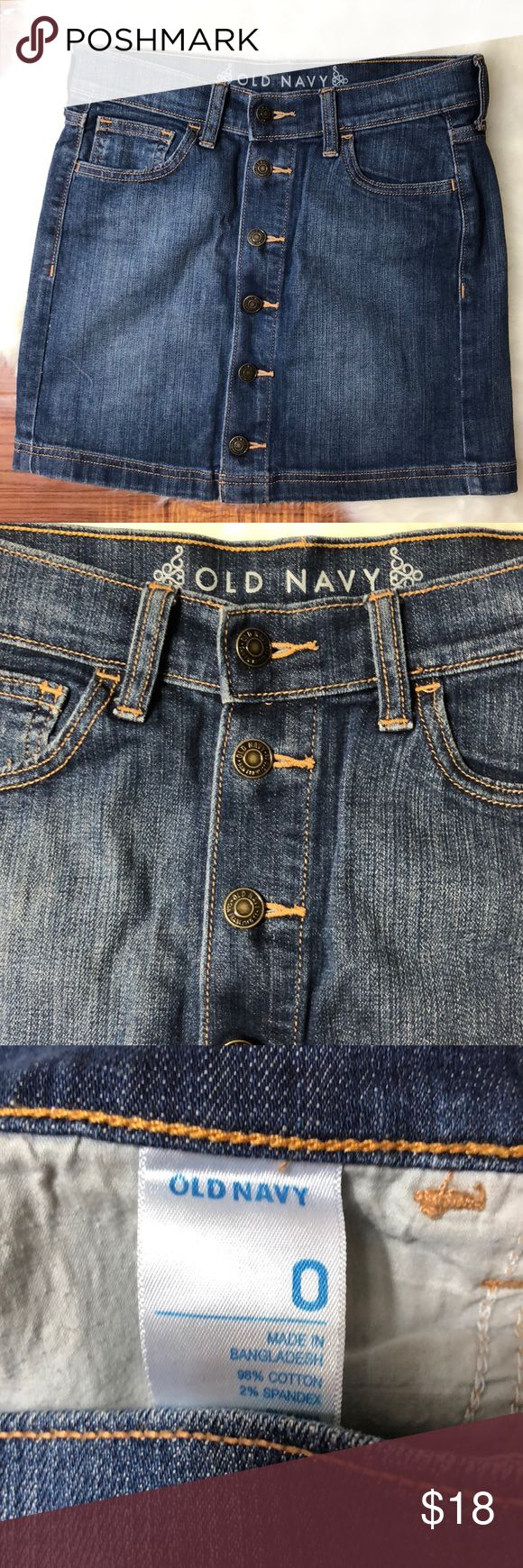 """OLD NAVY Dark Wash Button Down Denim Jeans Skirt Excellent used condition. Dark denim jeans mini skirt by Old Navy. Skirt is button down and has 2 side front pockets, 1 mini front pocket and 2 back pockets.  Materials: cotton spandex Waist (across) 14.5""""  Length 16""""  No trades.  We are a smoke and pet-free home. Old Navy Skirts Mini"""