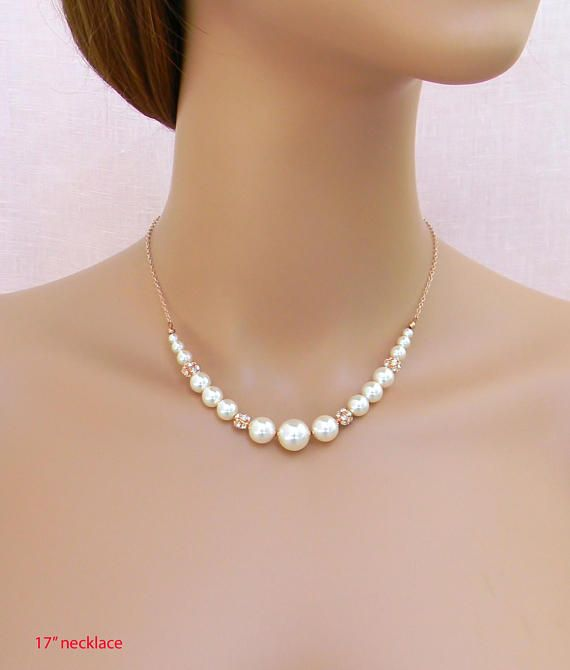 c756db7ccd52 The Bethany Bridal necklace is your classic pearl necklace with a little  pop! It boasts a short strand of pearls in the front with sterling silver  chain ...