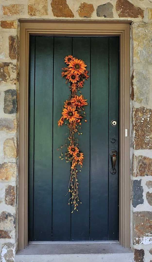 DIY Fall Flower Door Hanger | 21 DIY Fall Door Decorations, see more at http://diyready.com/21-diy-fall-door-decorations-wreaths-door-hangers-more