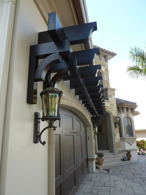 A trellis over a garage door adds a nice  architectural feature to a home. We designed and installed this garage trellis for a client in Naples FL. Architectural Structures of Naples, Inc. www.asoffl.com