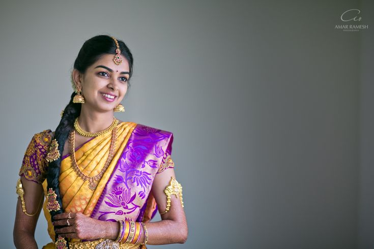 South Indian bride. Hindu bride. Yellow pink kanchipuram silk sari. Jhumki. Long braid with gold jewelry.