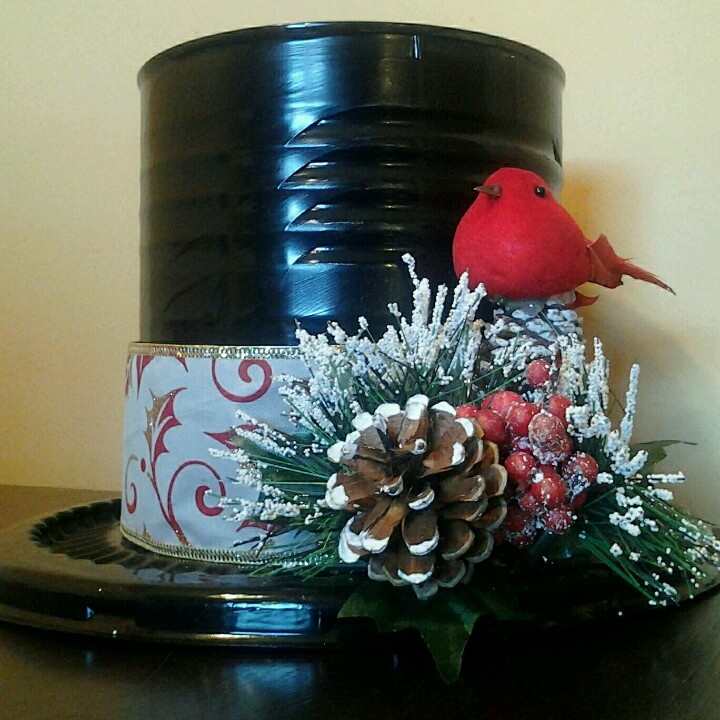 "One of the ""snowman hat"" gift tins. Coffee can, plastic bakery cookie lid and dollar store ribbon and decorations. To be filled with treats for friends!"
