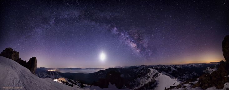 8-shot pano of the Moon and the Milky Way over Lake Tahoe. Light pollution from Placerville (I _think_) way off to the right. [oc][3000x1186]