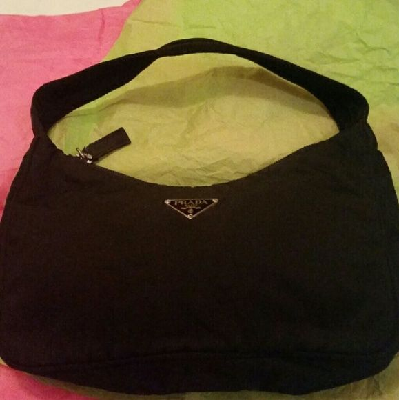 Little Prada Bag  / SALE SALE SALE SALE This is a smaller bag. Brand new with out tags. It is authentic,  you can tell by the inside, where the Prada sign is.  Great for holding cell phones, check book, and other things. Its black in color, and black on the inside. Prada Bags Mini Bags