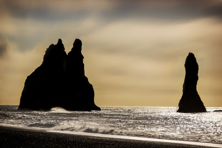 sunset - The black sand beach in Vik is called by its local Reynishverfi. It is famous because of it's black sand and basalt sea stack