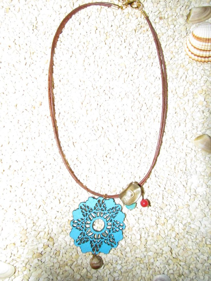 Handmade short necklace with turquoise leather filigree (1 pc)  Made with turquoise leather filigree, leather cords, brass metal and semiprecious stones.