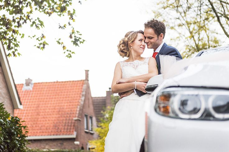 Wedding couple by the car