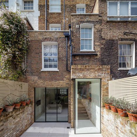 Moxon Architects has completed a contemporary glazed extension to this Grade II listed town house in south-west London