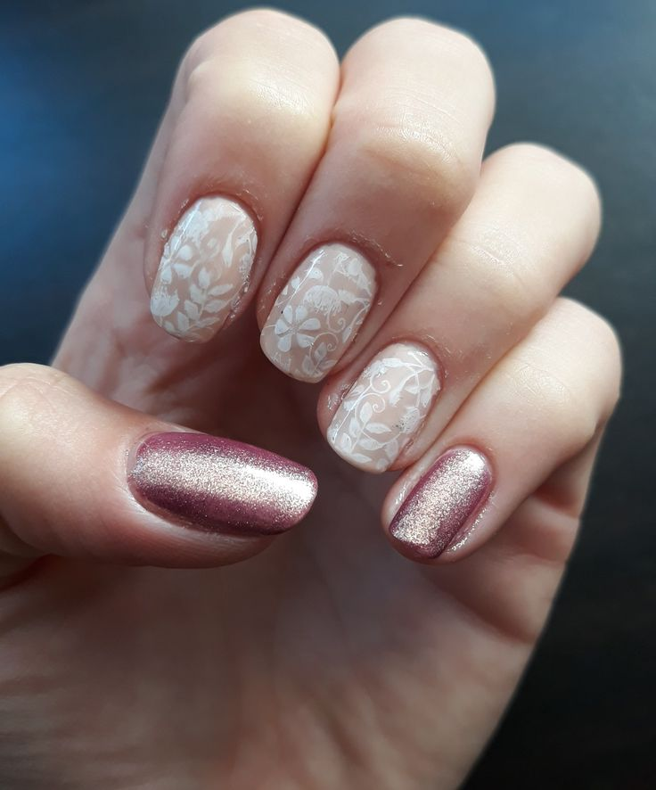 Nude nail polish with sparkle accent.