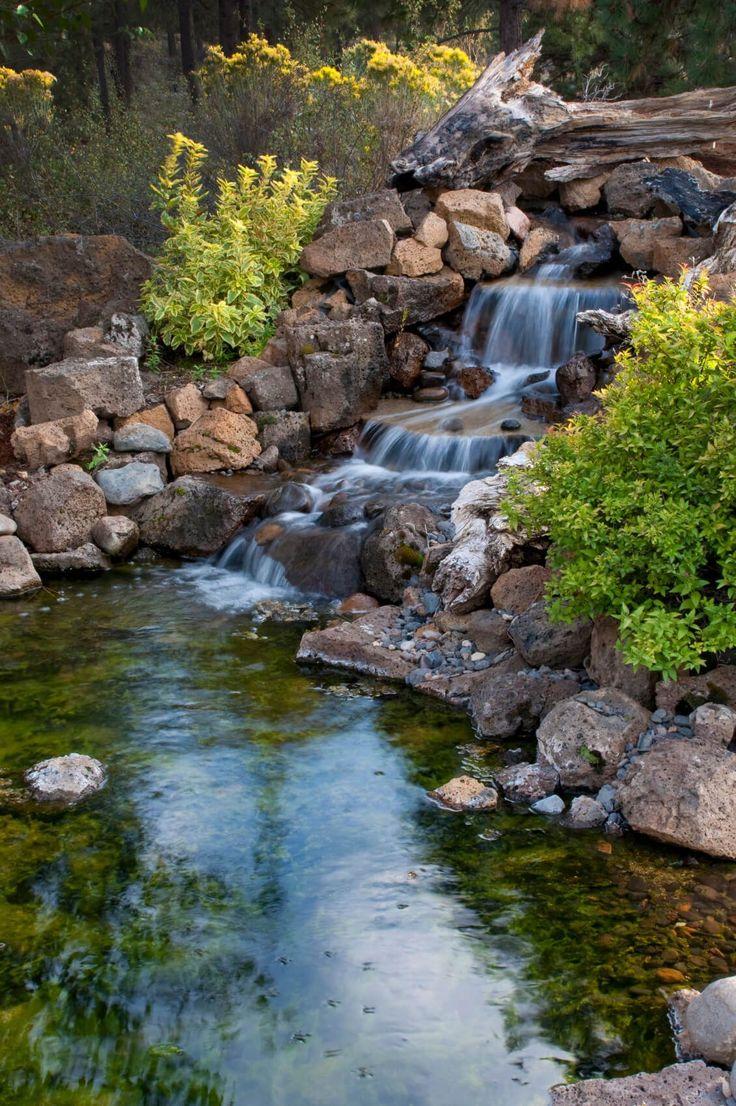 Best 25 rock waterfall ideas on pinterest dream pools for Rock waterfall pond