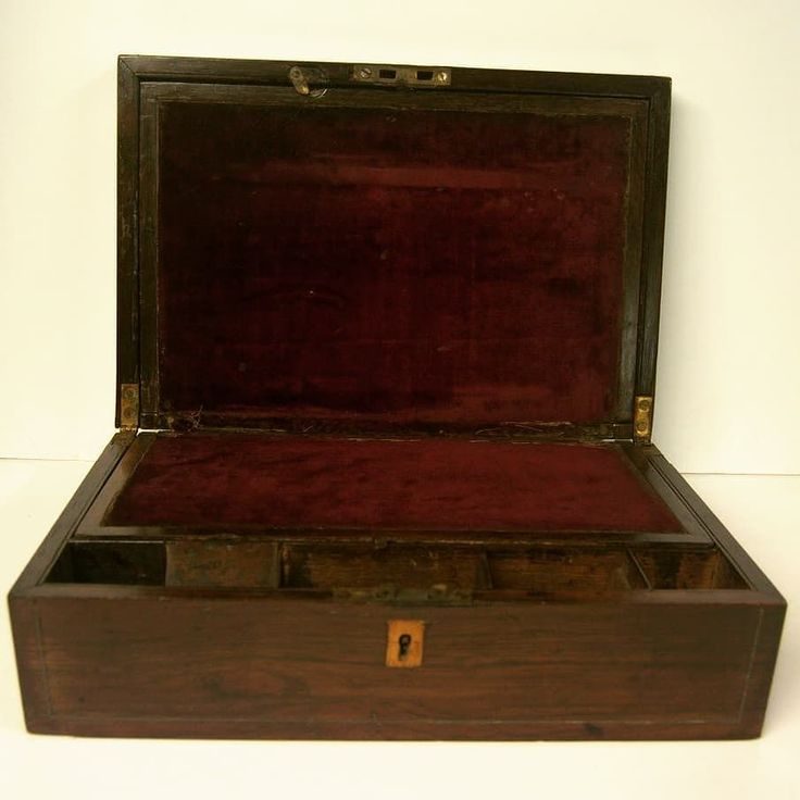 Victorian Rosewood Writing Box at D and A Binder | This beautiful writing box has plenty of space for your personal affairs - in fetching rosewood with mother of pearl inlay this is a practical and beautiful box. It has several compartments which lift and hide to ensure security and the inside is lined with a berry velvet. We do not have the original key unfortuanately. There is also brass string inlay. It is a very glamorous piece ideal as a Christmas gift or to keep personal effects safe…