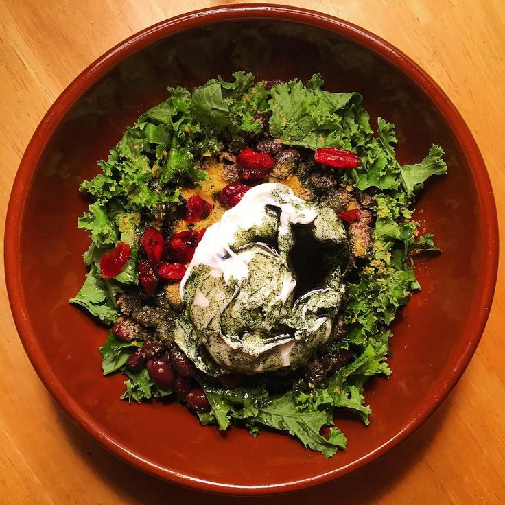 So fresh and so clean clean! Clean eating recipe:  bed of kale topped with black beans, dried cranberries, nutritional yeast, and a poached egg courtesy of a happy free-range hen living her organic life in Makawao • • drizzled with a mixture of olive oil, dry mustard, and spirulina