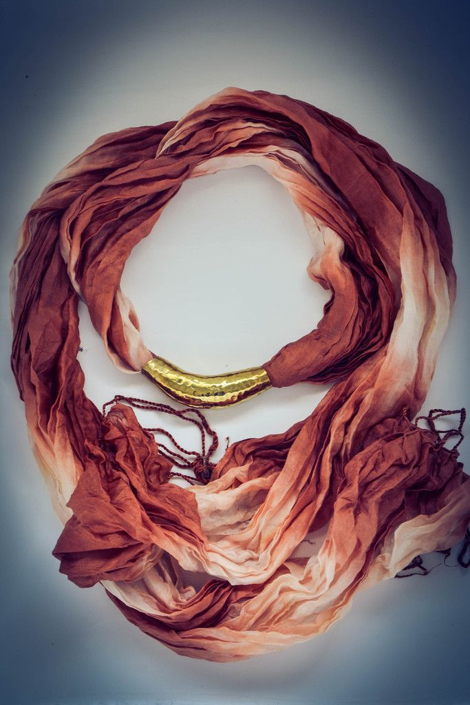 Handmade Cambodian Silk Scarf with Brass Choker centrepiece.    Part of our artisan jewellery 'Gold' collection which is handmade by a local artisan in Siem Reap, Cambodia from recycled brass bullet shells.  Available now at www.banteaysreyboutique.com