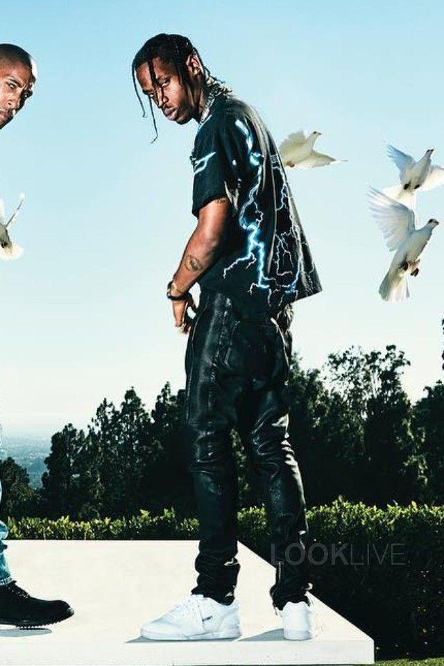 Travis Scott wearing  Balmain Biker Lounge Pants, Reebok Workout x Gosha Rubchinskiy  Sneakers, Vintage Daytona Beach Feel The Wind T-Shirt