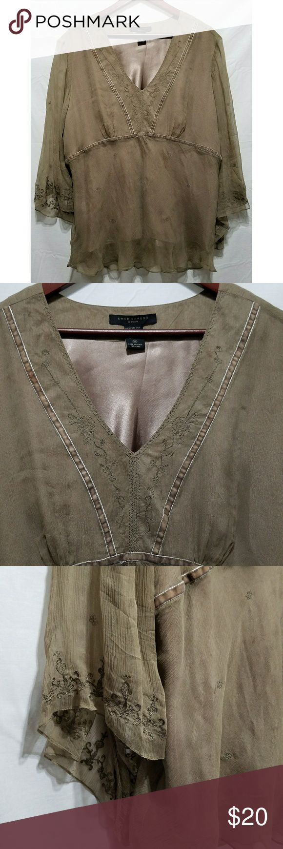 """Anne Carson Woman Brown Silk Embroidered Blouse Women's Anne Carson brown blouse, size 2X. It is embroidered silk with a polyester lining. The sleeves are sheer. It is in excellent used condition with no stains, tears, rips or holes that I can see.  Shell: 100% silk  Lining: 100% polyester   Chest: 54"""" Armpit to armpit: 27"""" Shoulder to hem: 27"""" Armpit to hem: 18"""" Sleeve: 17.5""""  All items come from a smoke and pet free home. Anne Carson Tops Blouses"""