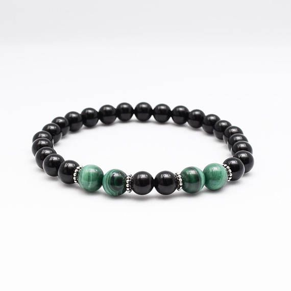 Malachite amplifies both positive and negative energies and is an important protection stone. It grounds spiritual energy onto the planet, and absorbs negative energies and pollutants, picking them up from the atmosphere and body. It soaks up plutonium pollution and guards against