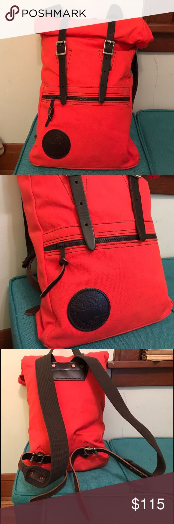 Bright Orange Duluth Roll Top Scout Pack This Duluth Pack scout pack is perfect for a day hike or while your commuting to work. You'll literally stand out from he crowd with this bright orange pack. Duluth Pack Bags Backpacks