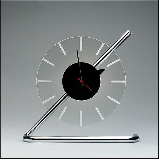 Electric clock designed by Gilbert Rohde for The Herman Miller Furniture Co., ca. 1933, chrome-plated metal, glass. Metropolitan Museum of Art.