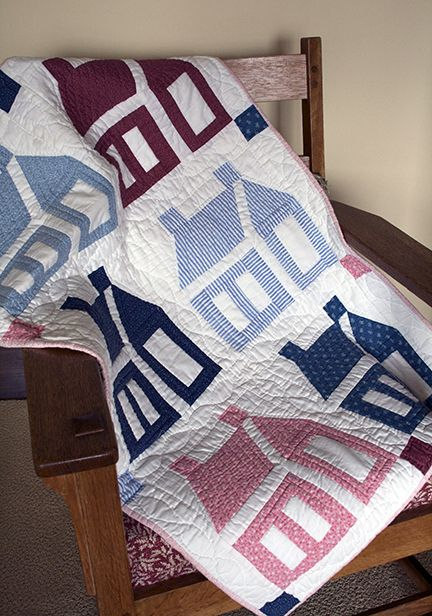 I like the old-fashioned look of this schoolhouse quilt