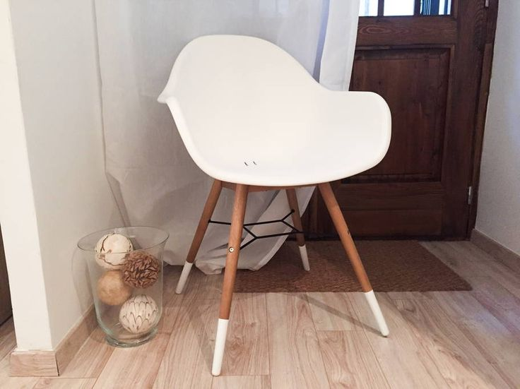 Wooden and white chair.