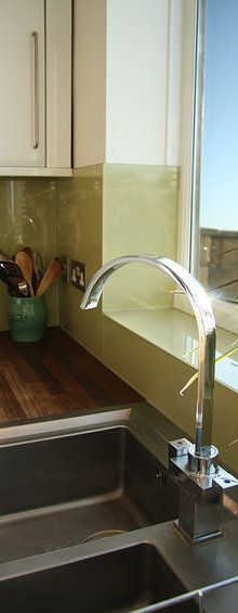 Glass splashback near window