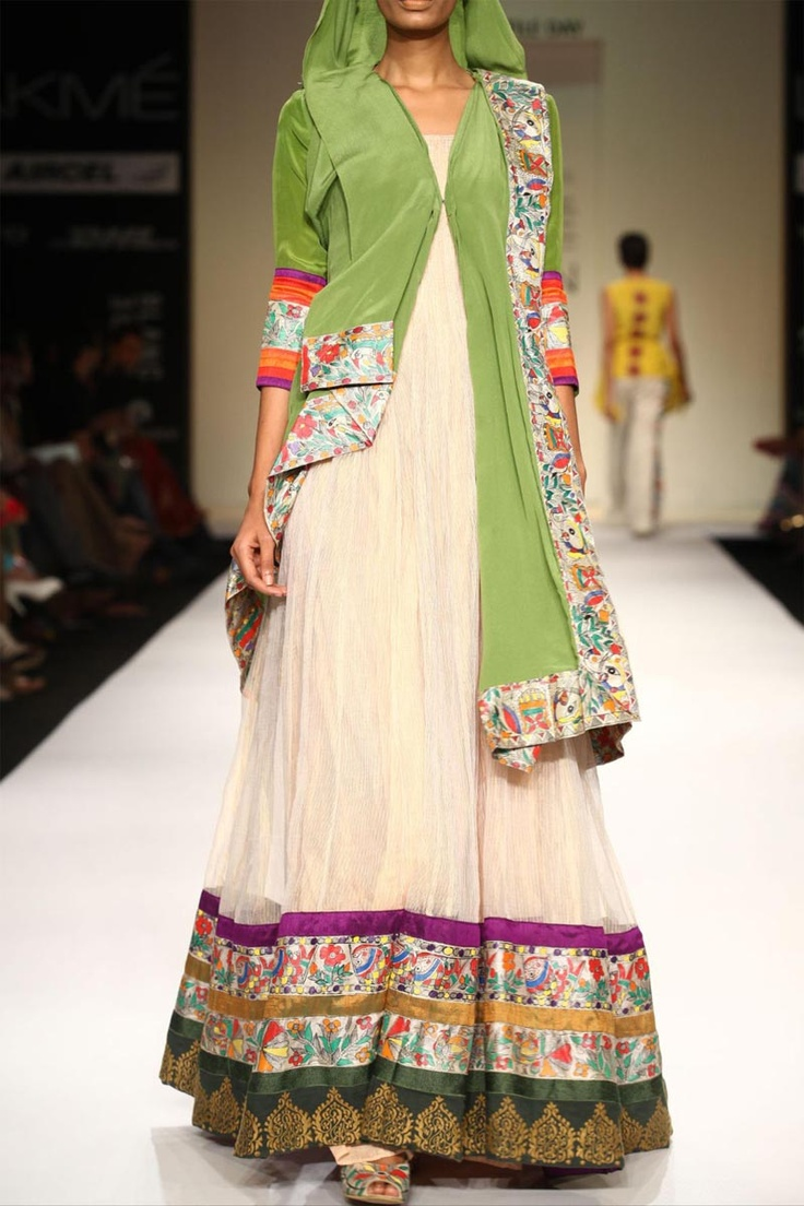 Mehendi green crepe jacket worn over gold Kota gown with Madhubani and gold embroidered borders