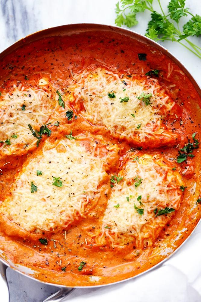 Creamy Tomato Italian Parmesan Chicken is a creamy red tomato parmesan sauce with delicious italian spices. The chicken gets smothered in melty parmesan cheese and will be one of the most delicious meals you eat! One pan meals have saved me this summer.