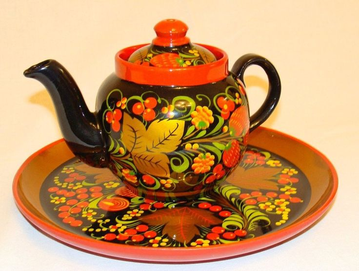 A teapot and a tray are decorated with Russian folk Khokhloma painting. #art #folk #painting #Russian