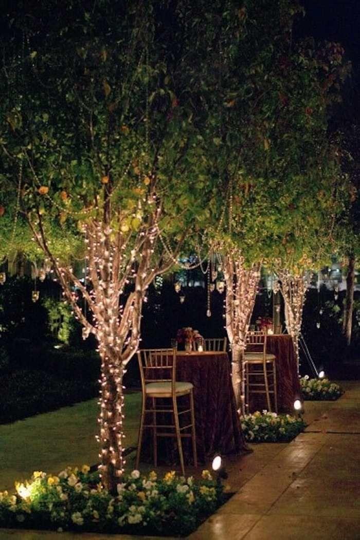 Tree lights set the ambiance so nice! Photo via Wedding Style Magazine