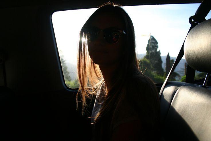 sunset lady in road trip by sebastian moreno
