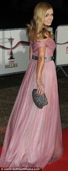 Blushing beauty: Katherine Jenkins opted for a blush pink gown which dipped dangerously low in