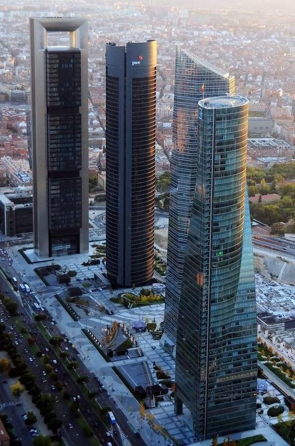 An aerial view of the Four Towers Business Area of Madrid, Spain. This is a landmark group of 4 contemporary skyscrapers, the tallest by Architect, Norman Foster. (V)