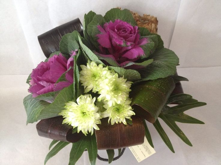 Receptions flowers for Coco Mousse hair salon, in Vastiy Lakes, stunning purple kale and lime green chrys.
