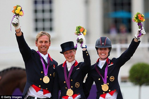 YAY!!! From left to right, Carl Hester, Laura Bechtolsheimer and Charlotte Dujardin of Great Britain celebrate with their historic GOLD medals in dressage