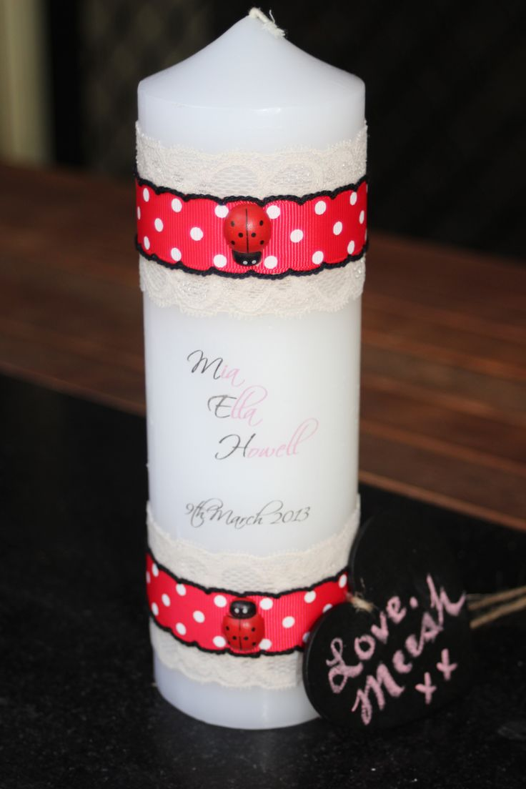 The Lady Beetle Girls Christening Candle.   Go to https://www.facebook.com/LoveMeeshxx  or contact me on lovemeeshxx@gmail.com.au to check out more designs.