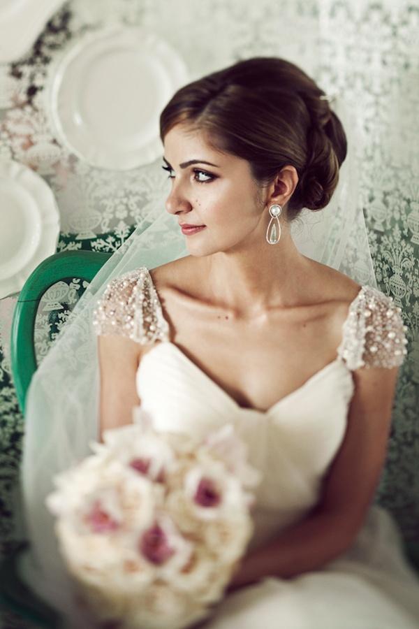Stunning bride in cap-sleeve wedding dress. Re-pin if you like. Via Inweddingdress.com #weddingdresses