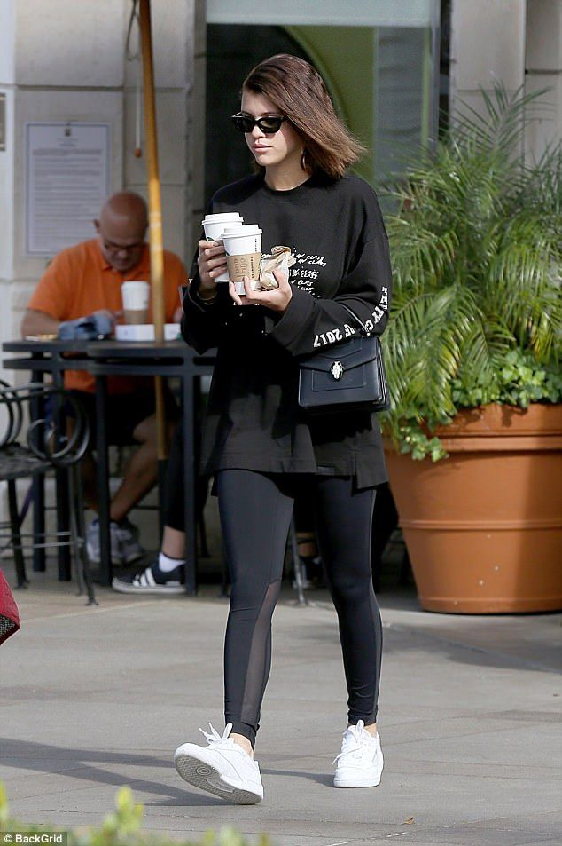 Sporty: The daughter of singer Lionel Richie was clad in a dark athletic ensemble...